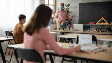 Teacher Teaching in a COVID Classroom