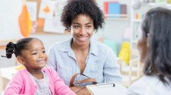Parent and teacher at a parent-teacher conference